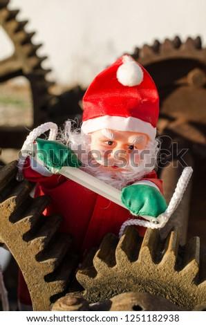 Santa in the cogwheels of consumerism, a concept