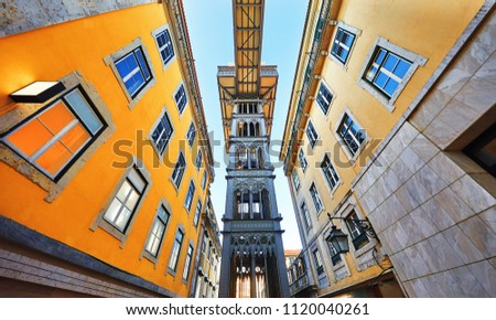 Santa Justa Lift in Lisbon. Famous landmark and entertaining touristic attraction with viewing platform upstairs. Old town among houses at narrow lane.
