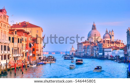 Santa Maria cathedral illuminated at sunset light near the famous Grand Canal, in Venice, Italy #546445801