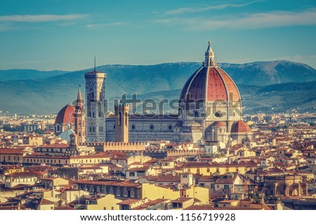 Santa Maria del Fiore cathedral in Florence, Italy in summer. Colourful skyline.