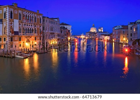 Santa Maria Della Salute, Church of Health, Grand canal Venice Italy with light trail of passenger cruise