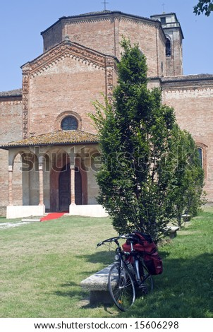 Santa Maria di Bressanoro (Cremona, Lombardy, Italy) - A bicycle with bags and the medieval church