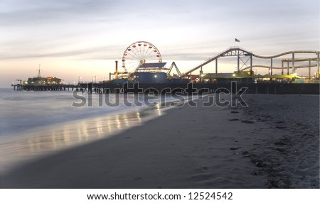 Santa Monica Beach, Santa Monica, CA May 3, 2008:  Horizontal image of the Santa Monica Pier with the prominent Ferris wheel and other thrill rides taken at dusk.