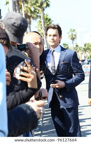 SANTA MONICA CA - FEBRUARY 25: White Collar star Matt Bomer poses for fan photo at the Independent Spirit Awards held at the beach in Santa Monica, CA February 25, 2012