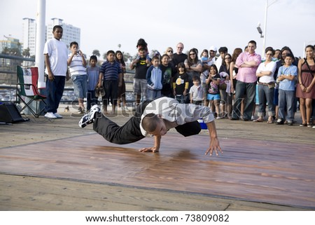 SANTA MONICA, CA - May 3, 2008:  B-Boy street performer break dances for the crowd on May 3, 2008 in Santa Monica, CA.