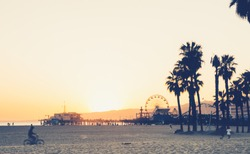 Santa Monica pier and beach at sunset, California
