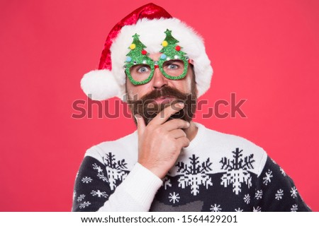 Santa needs good beard. Hipster touch beard hair in festive style. Bearded man with long mustache and beard. Beard styled for santa claus look. Mens grooming salon. Barbershop.