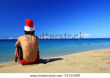 Santa on tropical beach