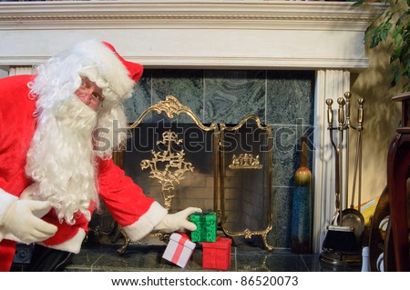 Santa placing some presents on the hearth looking surprised as he is caught doing it