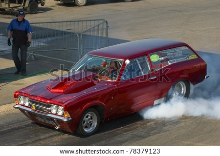 SANTA POD RACEWAY, UK - APRIL 23: An unidentified driver performs a burnout with a custom built British Ford Cortina Mk3 during the Big Bang Camper and Bus Festival at Santa Pod Raceway, UK on April 23, 2010.