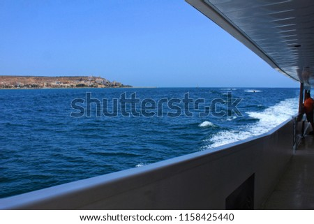 Santa Pola, Alicante, Spain- July 16, 2018: Boat Approaching the coast of Santa Pola, Alicante, Spain in a sunny day of summer #1158425440