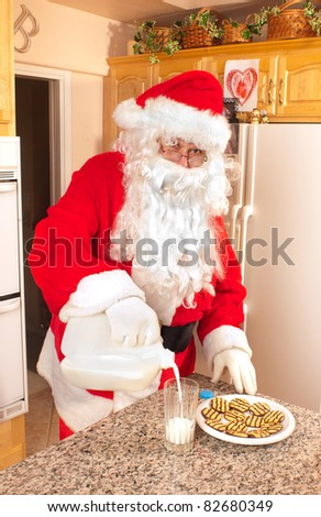 Santa pouring and drinking a glass of milk left out for him along with some cookies