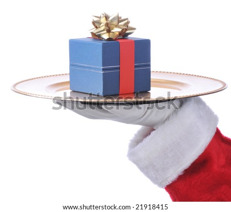 Santa's Hand Holding Up Serving Tray with Present isolated over white