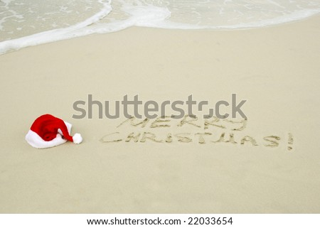 Santa\'s hat on a beach with Merry Christmas text