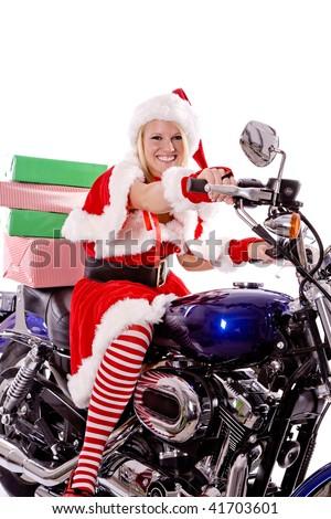 Santa's helper sitting on her motorbike delivering a stack of presents that sit on her bike.