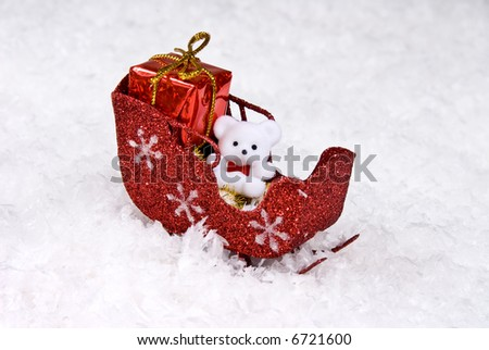 Santa's sleigh sits in a snowy wilderness with presents and decorated with white teddy bear
