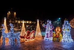 Santa, Snow White and a sleigh decoreted with lights. Pazardzhik city centre Christmas decorations.