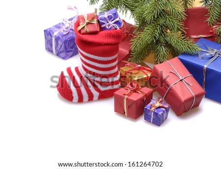 santa stocking  and  gift boxes  under decorated Christmas tree.isolated on white background