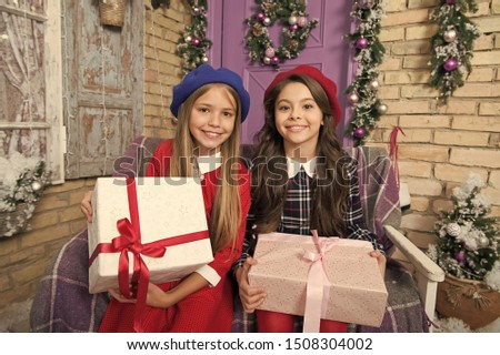 Santa visits us only once a year. Cute children with new year presents. Merry Christmas and Happy New Year. Happy little girls hold gift boxes. Festive preparation for Christmas and New Year at home. #1508304002