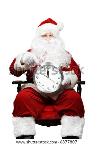 Santa with a clock - stock photo