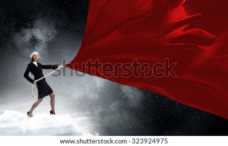 Santa woman in suit pulling red clothing banner #323924975