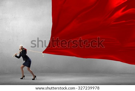 Santa woman in suit pulling red clothing banner - Shutterstock ID 327239978