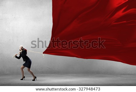 Santa woman in suit pulling red clothing banner - Shutterstock ID 327948473