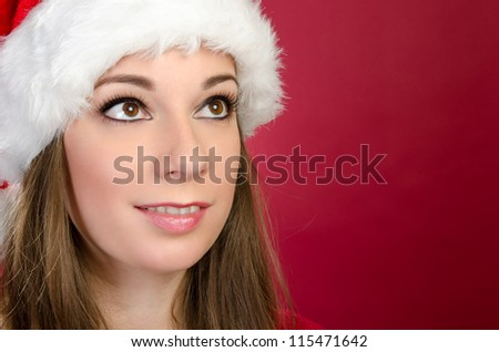 Santa Woman looking up with red background