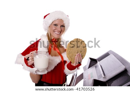Santas helper exercising on a treadmill getting ready for Christmas holding her cookie and a big glass of milk.