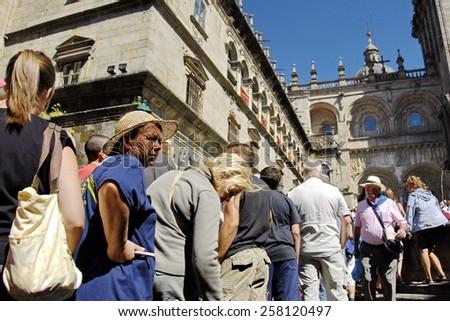 SANTIAGO DE COMPOSTELA, SPAIN - JULY 25: Unidentified Catholic pilgrims wait their turn to St. James Cathedral on Saint James Day, Santiago, Spain, July 25, 2010. It\'s a Holy Year for many Catholics.