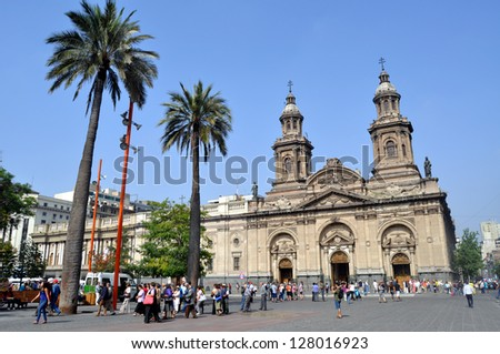 SANTIAGO - FEBRUARY 1, 2012: Summer brings tourists to downtown Santiago. Visitors gather in front of the Santiago Cathedral at Plaza de Armas in the city�s historic center on February 1, 2013.