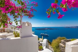 Santorini, Greece. Famous view of traditional white architecture Santorini landscape with flowers in foreground. Summer vacations background. Luxury travel tourism concept. Amazing summer destination