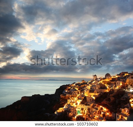 Santorini in the evening, Oia village with windmills, Greece