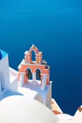 Santorini island in Greece. Aegean sea anf typical greek church with belfry