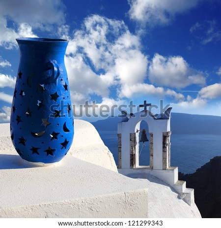 Santorini island with church and blue vase in Greece