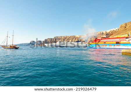 SANTORINI-JULY 28: Ferrys arrive to the  port of Thira on July 28, 2014 on the Santorini(Thera) island, Greece.