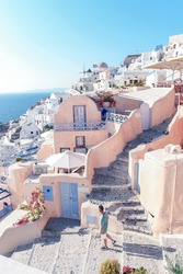 Santorini Oia Greece, Young man looking at the historical village withe white washed houses at Oia Santorini