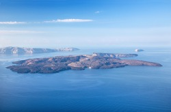 Santorini - The islands Nea Kameni and Palea Kameni and the south part of the Island in background.