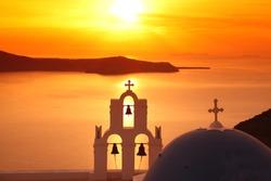 Santorini with Firostefani Church against sunset over sea, Fira, Greece