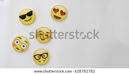 SAO PAULO, BRAZIL - April 26, 2017 - Emoji Reactions isolated in a white background. Emotions smiles faces with a blank space for illustrative editorial.