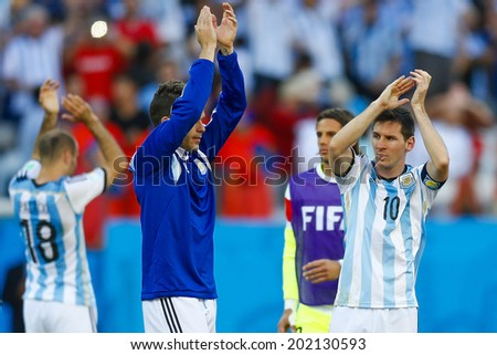 SAO PAULO, BRAZIL - July 1, 2014: Lionel Messi of Argentina celebrates winning the 2014 World Cup Round of 16 game against Switzerland at Arena Corinthians. No Use in Brazil.