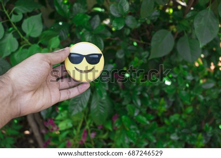 SAO PAULO, BRAZIL - July 31, 2017 - Man holding a Emoji. Emojis smiles faces for illustrative editorial. Emojis copyrights to Apple.