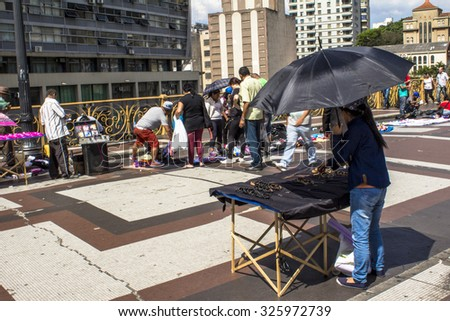 Sao Paulo, Brazil, October 09, 2015. Ambulante vendors and people walking on the Santa Ifigenia Viaduct, in downtown Sao Paulo, Brazil. #325972739