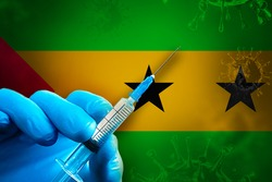 Sao Tome and Principe Covid-19 Vaccination Campaign. A hand in a blue rubber glove holds a syringe with covid-19 virus vaccine in front of Sao Tome and Principe flag. Coronavirus vaccination concept