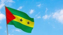 Sao Tome and Principe flag on pole. Blue sky. National flag of Sao Tome and Principe