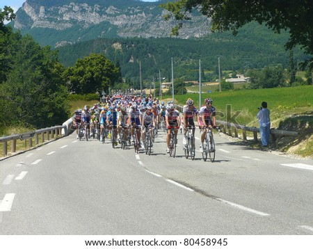 "SAOU, FRANCE - JUNE 11: Professional racing cyclists ride in the fifth stage time trial of the UCI World Tour, ""Criterum du Dauphine Libere"" on June 11, 2009 in Saou, Drome, France."