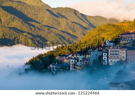 Sapa valley city in the mist in the morning, Vietnam - stock photo