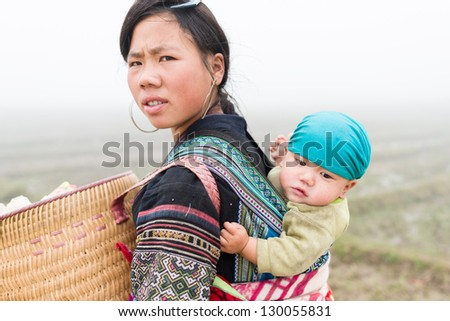 SAPA, VIETNAM - DEC 04: Unidentified H'mong woman and child in Sa Pa, Vietnam December 04, 2012. Sapa is a mountain town in Vietnam and H'mong are the 8th largest ethnic group in Vietnam.