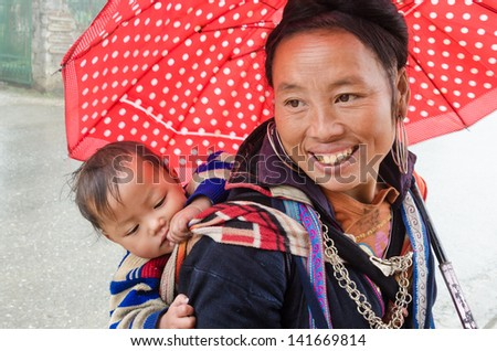 SAPA, VIETNAM - DEC 02: Unidentified H'mong woman in Sa Pa, Vietnam December 02, 2012. Sapa is a mountain town in Vietnam and H'mong are the 8th largest ethnic group in Vietnam.