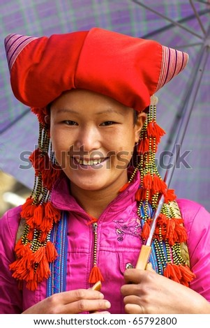 SAPA,VIETNAM - NOV 22: Unidentified girl of the Red Dao Ethnic group November 22, 2010 in Sapa, Vietnam.  Red Dao is the 9th largest ethnic group in Vietnam with just under 500,000 people.